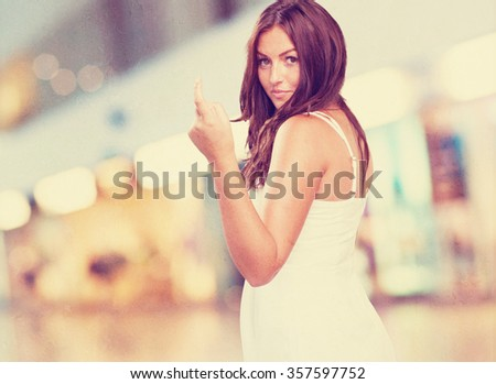 pretty young woman doing a sexy gesture - stock photo