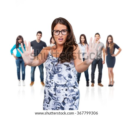 pretty young woman doing a stop gesture - stock photo