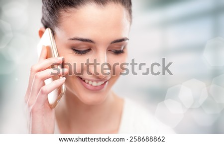 Pretty young woman having a phone call with her mobile  - stock photo