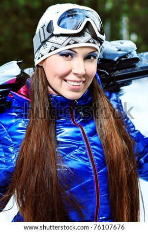 Pretty young woman having winter rest outdoor. - stock photo
