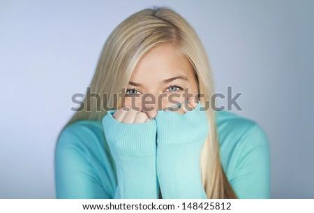 Pretty young woman hiding - stock photo