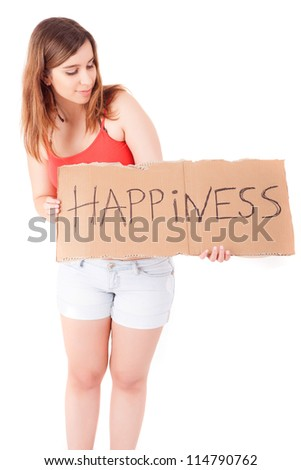 Pretty young woman holding happiness card