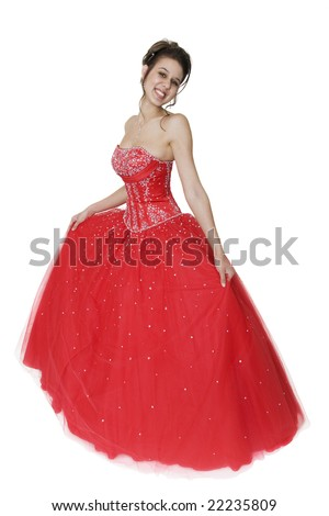 Pretty young woman in a beautiful strapless ball gown. - stock photo