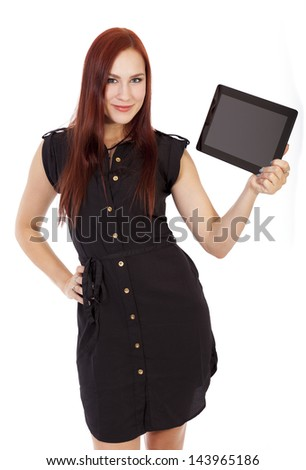 Pretty young woman in a blue dress smiles while holding a tablet computer.