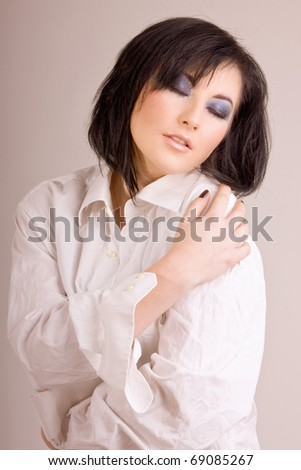 Pretty young woman in a white men's shirt - stock photo