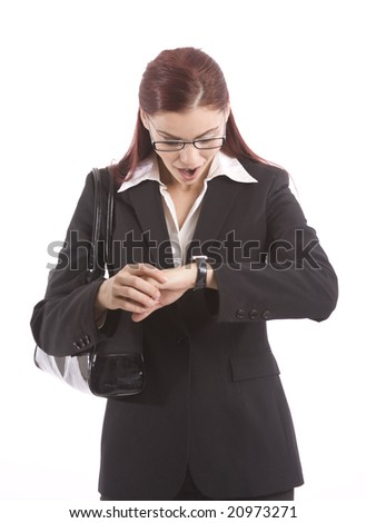Pretty  young woman in business attire checking her watch - stock photo