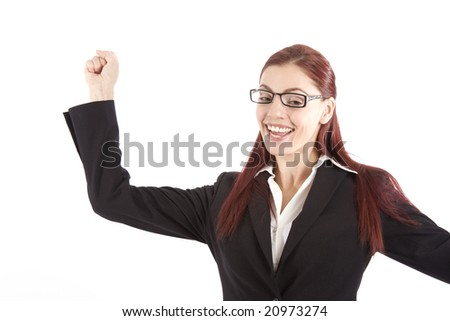 Pretty young woman in business attire raising her arm in celebration - stock photo