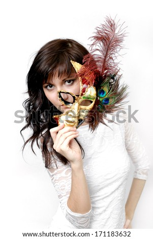 Pretty young woman in Carnival Venetian mask - stock photo