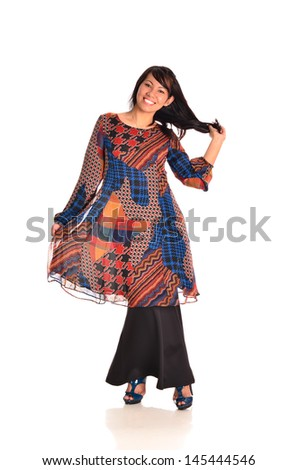 Pretty young woman in catwalk action on white background - stock photo