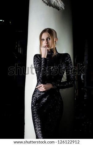 Pretty young woman in fashion black dress