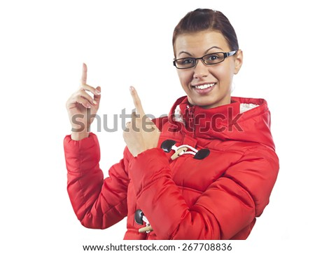 Pretty young woman in red coat - stock photo