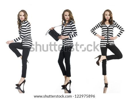 Pretty young woman in stripy shirt and jeans, bag posing at studio - stock photo