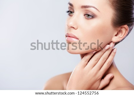 Pretty young woman in studio - stock photo