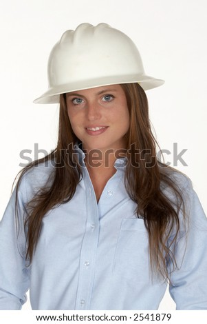 Pretty Young Woman in White Hardhat and Blue Shirt - stock photo