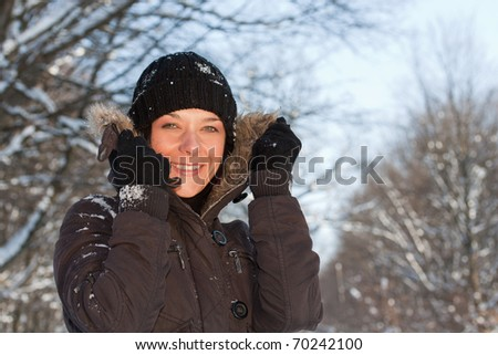 Pretty young woman in winter forest.