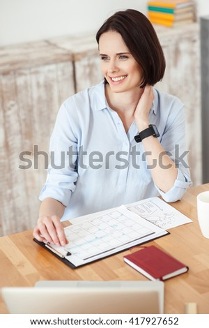 Pretty young woman is doing paperwork