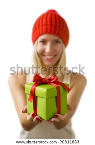 Pretty young woman is holding a gift box - stock photo