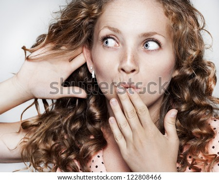 Pretty young woman listening to gossip - stock photo