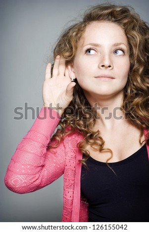 Pretty young woman listening to gossip