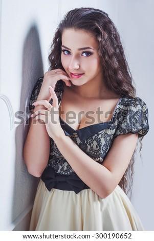 Pretty young woman looking at camera - stock photo