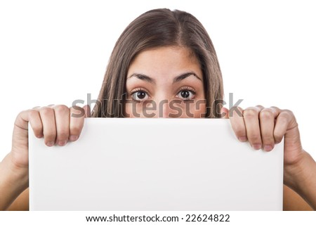 Pretty young woman looking over the top of her laptop