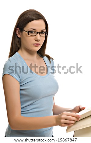 Pretty young woman looks up from her book - stock photo
