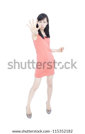 pretty young woman making stop hand sign, isolated over white background - stock photo