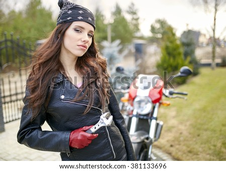 pretty young woman motorcyclist. motorcycle style