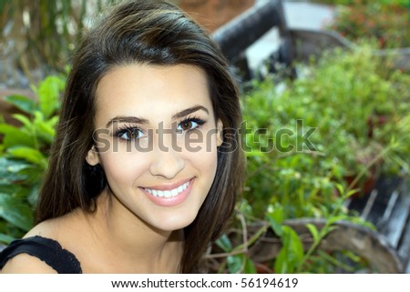 Pretty Young Woman on a Park Bench - stock photo