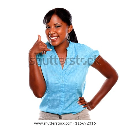 Pretty young woman on blue shirt saying call me on isolated background - stock photo