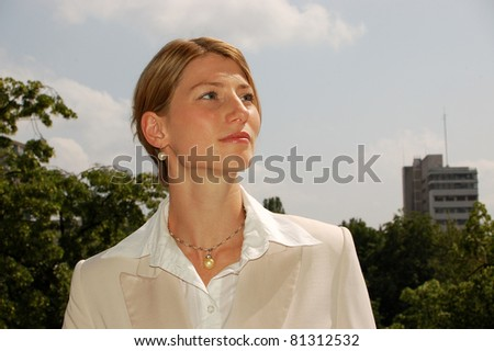 Pretty young Woman on the Top of a Building - stock photo