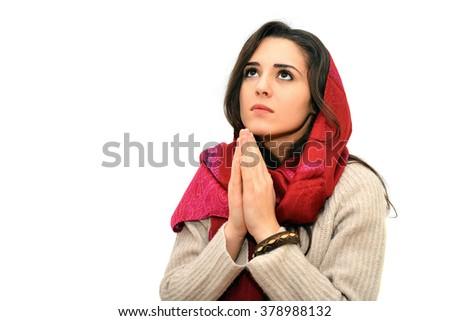 pretty young woman praying   - stock photo