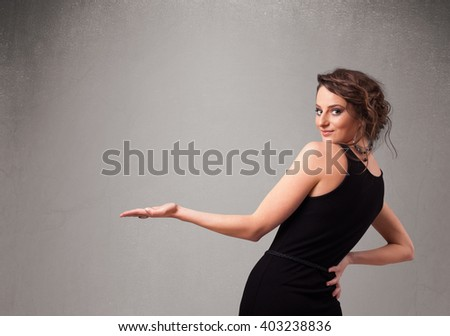 Pretty young woman presenting an empty copy space