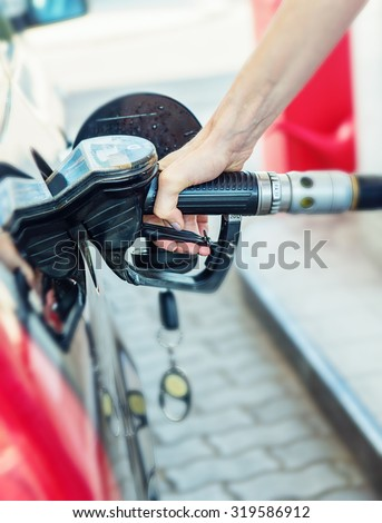 Pretty young woman refuel the car, detail photo - stock photo