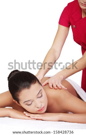 Pretty young woman relaxing being massaged isoalted on white  - stock photo