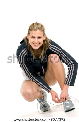 Pretty young woman sitting over white background - stock photo