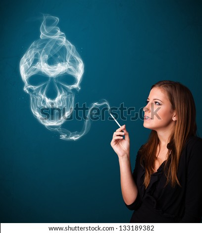 Pretty young woman smoking dangerous cigarette with toxic skull smoke - stock photo