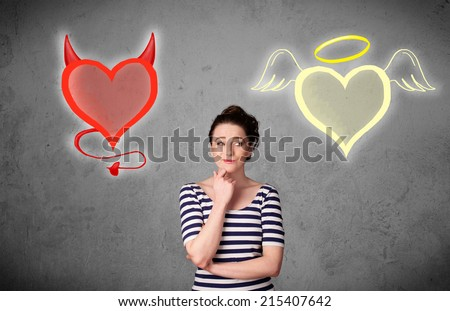 Pretty young woman standing and deciding between the angel and the devil heart - stock photo