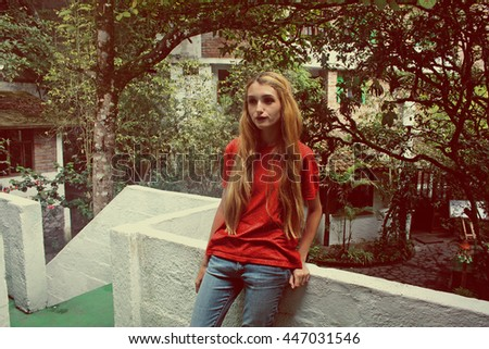 Pretty, young woman standing on terrace and enjoying day, Ecuador - stock photo