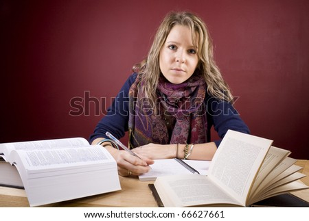 Pretty, young woman studying in a home environment. - stock photo