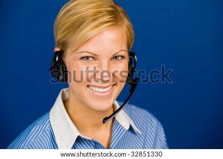 Pretty young woman takes calls as a customer service operator