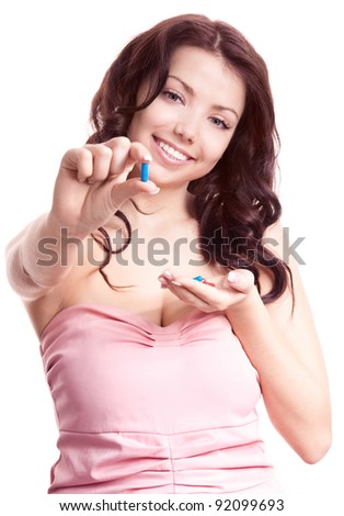 pretty young woman taking pills, isolated against white background (focus on the face) - stock photo