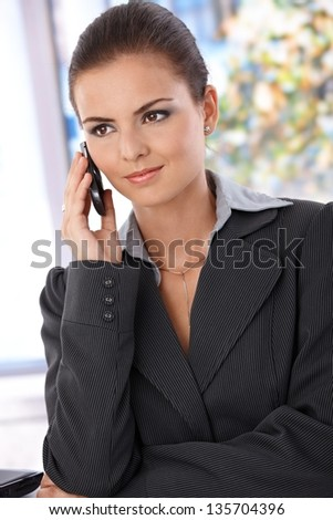 Pretty young woman talking on mobile phone. - stock photo