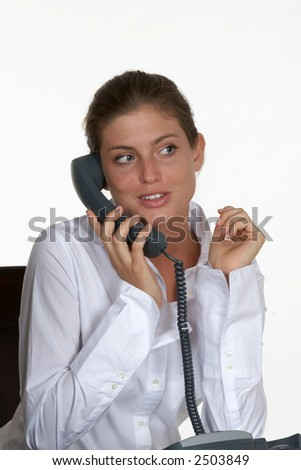 Pretty Young Woman Talking on Office Phone - stock photo