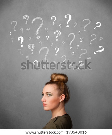 Pretty young woman thinking with sketched question marks all over her head - stock photo