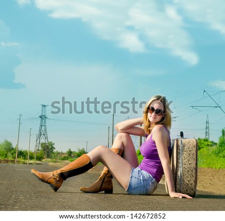 Pretty young woman waiting on the road