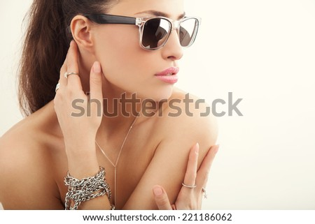 pretty young woman wearing modern sunglasses, studio white