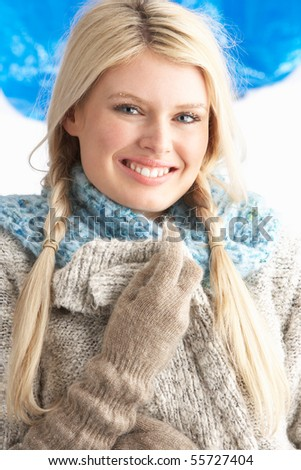Pretty Young Woman Wearing Warm Winter Clothes In Studio - stock photo