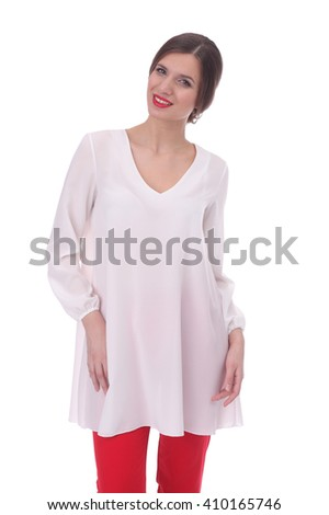 pretty young woman wearing white tunic and red pants - stock photo