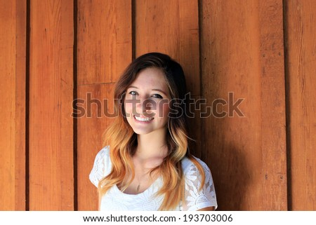 Pretty young woman with a friendly smile. - stock photo